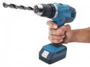 hand holding a power drill