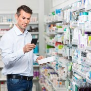 male consumer purchasing pharmacy items