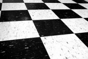 black and white vinyl tile arranged in a checkerboard pattern