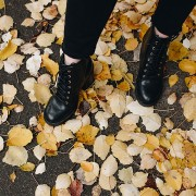 Woman Wearing Black Leather Boots