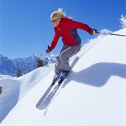 Young Woman Skiing Downhill