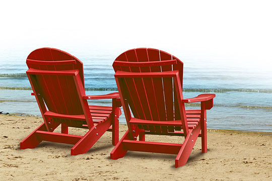 two chairs on a sandy beach