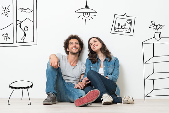 young couple at home, sitting on floor