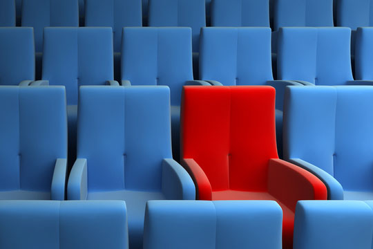 red seat in an auditorium