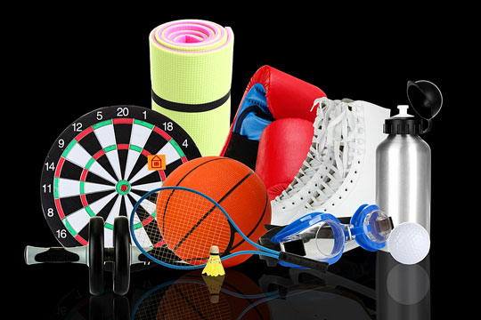 sporting goods on black background