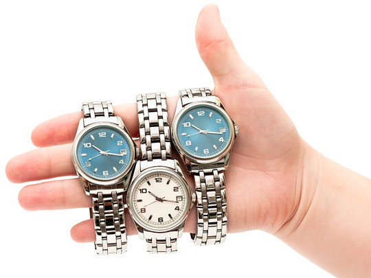 three watches on a woman's hand